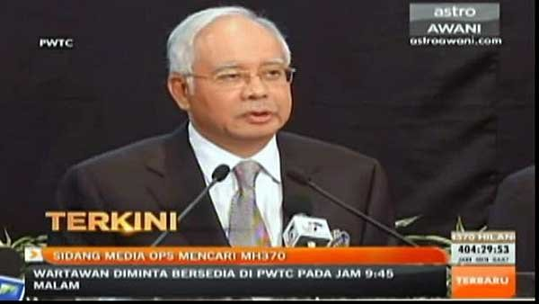 Malaysia Prime Minister Najib Razak said calculations by U.K. officials and satellite data showed MH370 likely crashed in the middle of the Indian Ocean. (Source: PWTC/CNN)