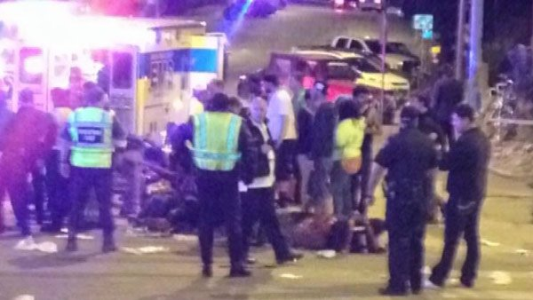 The car plowed past a barricade and into a crowd early Thursday, killing 2 and injuring 23. (Source: KXAN/CNN)