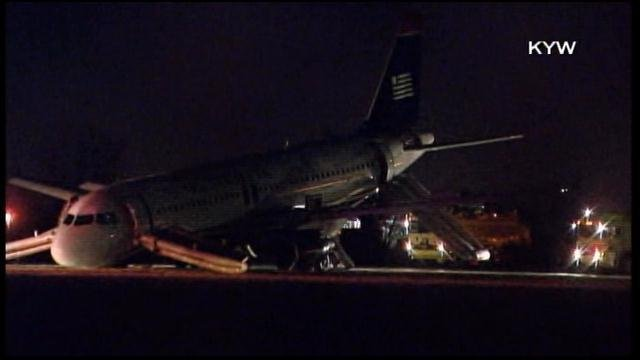 A blown nose gear caused the grounding of a flight at Philadelphia International Airport. (Source: KYW/CNN)