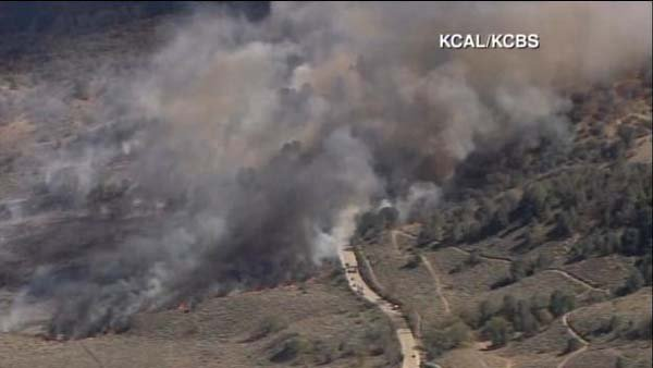 Three homes have been evacuated due to a fast-moving brush fire. (Source: KCAL/CNN)