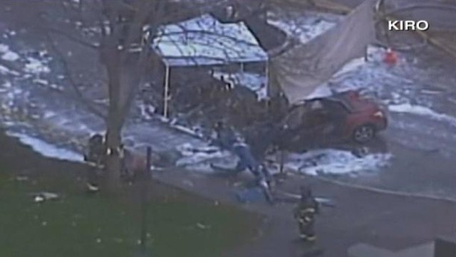 An aerial view of the helicopter crash Tuesday near the Seattle Space Needle. (Source: KIRO)