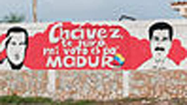 A campaign sign links the political fortunes of Chavez and Maduro, on the right. (Source: Wikimedia Commons)
