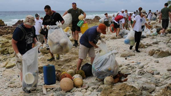 U.S. military personnel and residents of Diego Garcia, in the Indian Ocean, cleaned up 4,100 pounds of trash in a beach cleanup in 2012. (Source:  Seaman Eric A. Pastor/U.S. Navy)