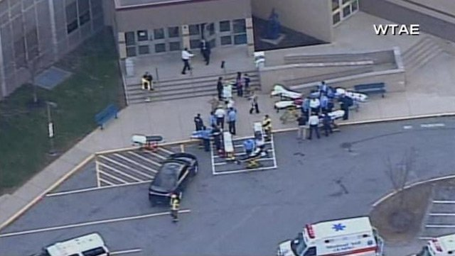 EMTs stand ready with hospital gurneys outside Franklin Regional High School, where a mass stabbing took place Wednesday. (Source: WTAE/CNN)