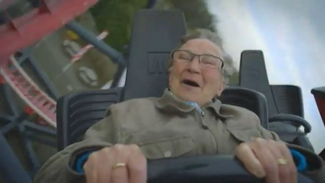 A Dutch grandmother's joyous ride on a roller coaster is caught on video. (Source: Vodafone Firsts/YouTube)