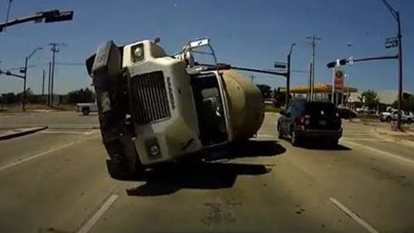 A dashboard camera caught footage of a cement truck running a red light and sliding head first into a minivan. (Source:CBSNews.com Web Extras/YouTube)