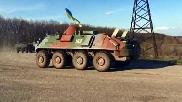A convoy of Ukrainian soldiers and armored personnel carriers leave the city of Donetsk heading east. (Source: CNN)