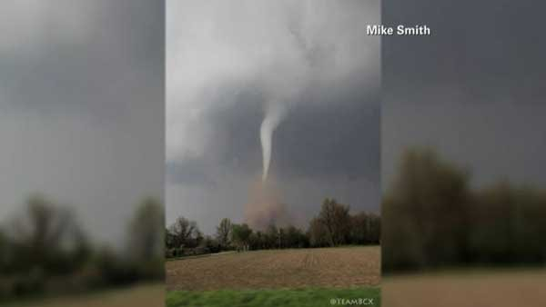 A funnel cloud kicked up dust in a field in Baxter Springs, KS, on Sunday. (Source: Mike Smith/CNN)