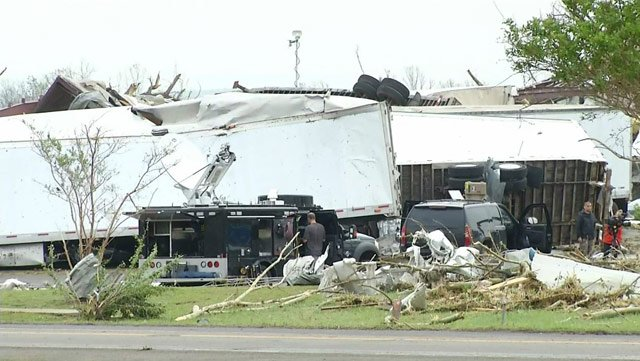 Severe storms tore through buildings and flipped trucks in Mayflower, AR, on Sunday. (Source: CNN)