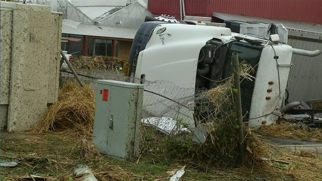 A truck was flipped on its side in Mayflower, AR, by a tornado Sunday. (Source: CNN)