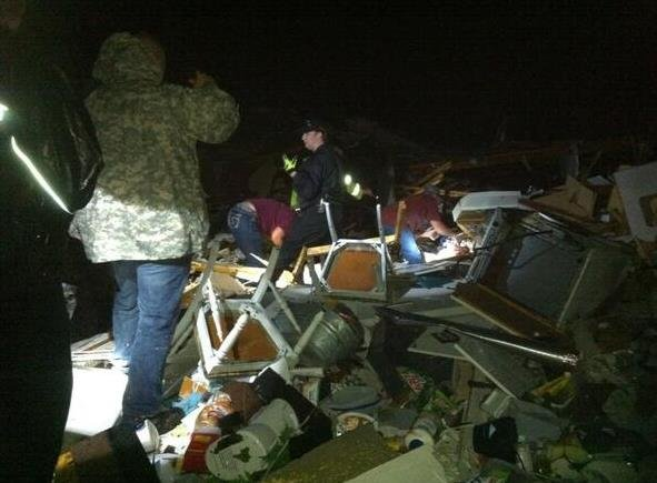 Rescuers search for people in the rubble of a home near Oneonta, AL. (Source: WBRC)