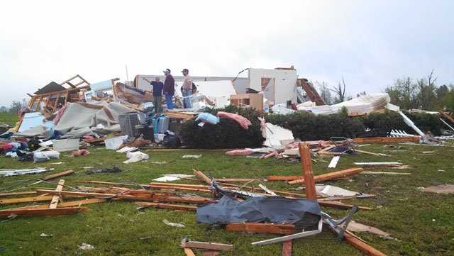 People look over the damage in Etowah County, AL, on Tuesday. (Source: WAFF)