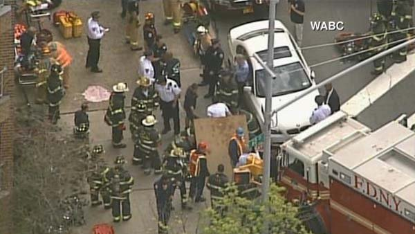 New York City firefighters help passengers out of a subway tunnel after a minor derailment. (Source: WABC/CNN)