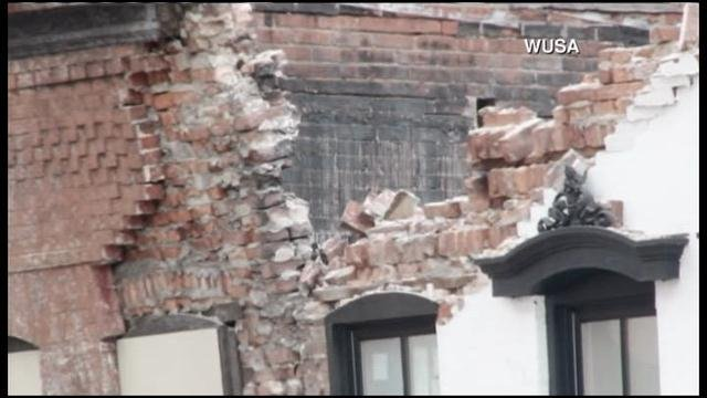 A building near a gentlemen's club in Washington, DC collapsed Friday. (Source: WUSA/CNN)