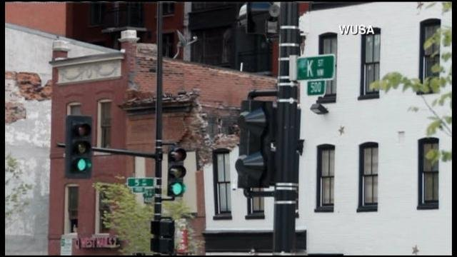 A building collapsed adjacent to a Washington, DC gentlemen's club on Friday. (Source: WJLA/CNN)
