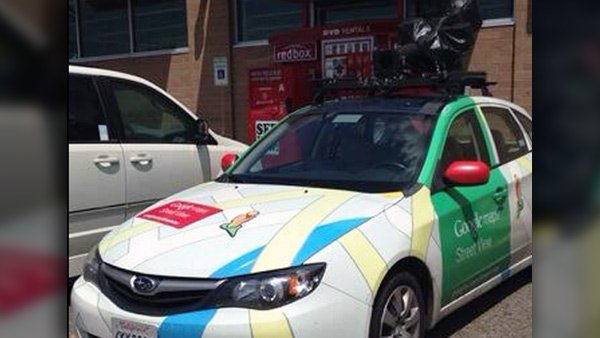 A Google Street View vehicle is parked in Prattville, AL, with its special camera hidden under a black tarp atop the vehicle. (Source: RNN)
