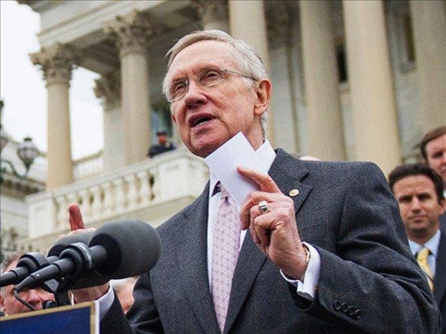 Senate Majority Leader Harry Reid and other Democrats have pledged to bring a bill to increase the minimum wage up for vote again before November elections. File photo of Reid from Oct. 9, 20