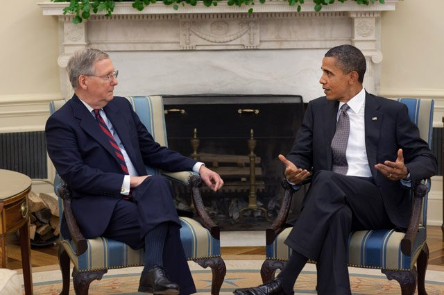 "Senate Minority Leader Mitch McConnell said a proposed minimum wage increase would ""cost 1 million jobs."" McConnell, left, sits next to President Barack Obama in a 2010 file photo. (Source: White House)"