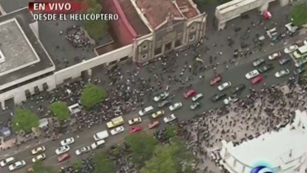 People rush into the streets in Mexico City after a 6.8 earthquake. (Source: FORO TV/CNN)