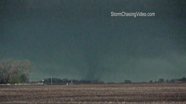 A rain-wrapped tornado twists in Seward County, NE, on Sunday. (Source: Stormchasingvideo.com/CNN)