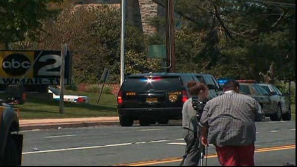 Police are lined outside WMAR, a TV station in the Baltimore area, after a man crashed a large truck into the building. (Source: CNN)