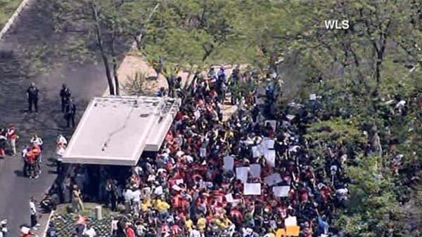 Hundreds of protesters gathered outside of McDonald's corporate headquarters in Illinois on Wednesday. (Source: WLS/CNN)