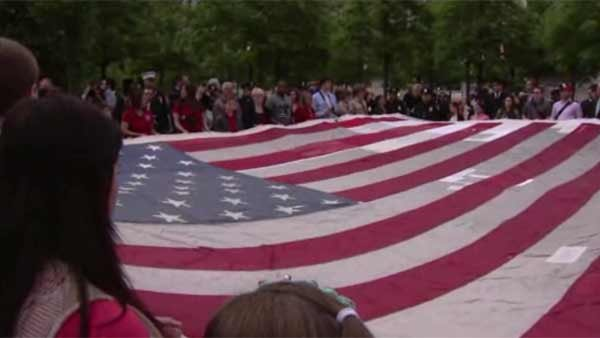 The flag that flew over Ground Zero was unfurled during a ceremony at the public opening of the 9/11 Memorial Museum on Wednesday. (Source: WCBS/POOL/CNN)