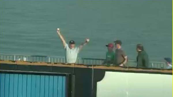 Marty Gregor has a 'that's my boy' moment after catching his son's home run.  (Source: MILB.com)