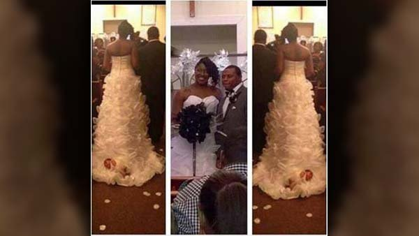 A woman who attached her baby to the train of her wedding dress said the baby was safe and secure. (Source: Shona Carter-BrooksFacebook)