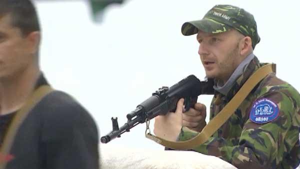 A pro-Russian separatist guards a checkpoint in the breakaway Donetsk region in eastern Ukraine. (Source: CNN)