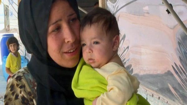 Hiba, shown with her 2-month old son Taha, is one of thousands of Syrian refugees who said she would not vote for President Bashar Al-Assad. (Source: CNN)