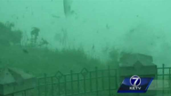 Debris blows in the winds moving more than 80 mph in Council Bluff, NE on Tuesday. (Source: KETV/CNN)