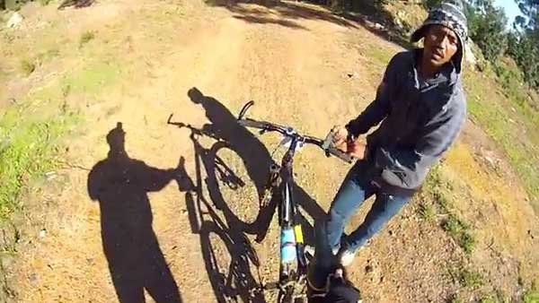 One suspect takes the victim's bike as the victim's GoPro camera attached to his helmet captures the act. (Source: YouTube/Lucky Jakkals)