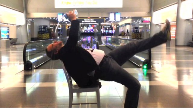 A traveler recorded a music video lip synching to 'All By Myself' during an overnight stay at the Las Vegas airport. (Source: Vimeo/Richard Dunn)