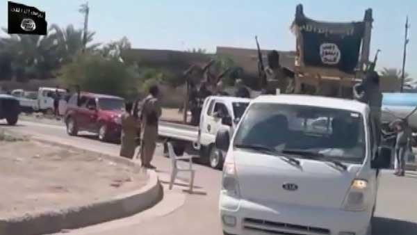 The ISIS terrorists moving toward Baghdad parade weapons captured from the Iraqi army as it fled in the face of the brutal militants. (Source: CNN)