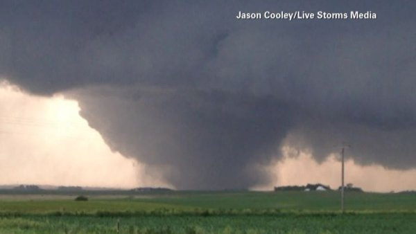 A second day of severe weather hit Nebraska, with this tornado touching down in Coleridge, NE on Tuesday. (Source: Jason Cooley/Live Storms Media/CNN)