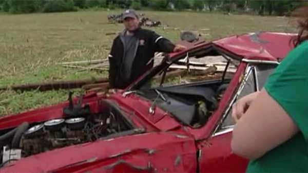 A man loses most of his dream car collection when a twister hit a storage barn in Wisconsin on Tuesday. (Source: WISC/CNN)