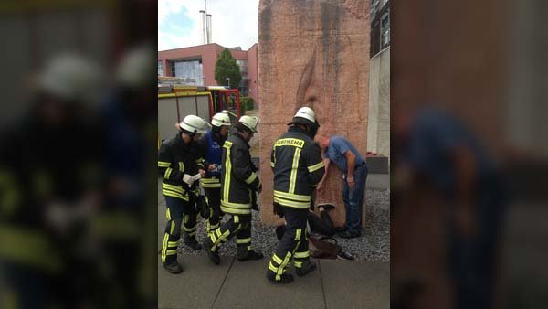 Two dozen firefighters pulled the young man out of the giant sculpture. (Source: Erick Guzman/Imgur)