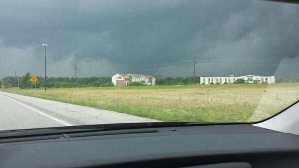 The tornado could be seen near the airport on I-70. (Source: Michael Adams/@dookiestl/Twitter)