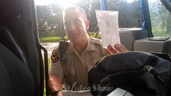 An Illinois state trooper who pulled over a truck driver changed his tone when informed he was being recorded. (Source: Brian Miner/YouTube)