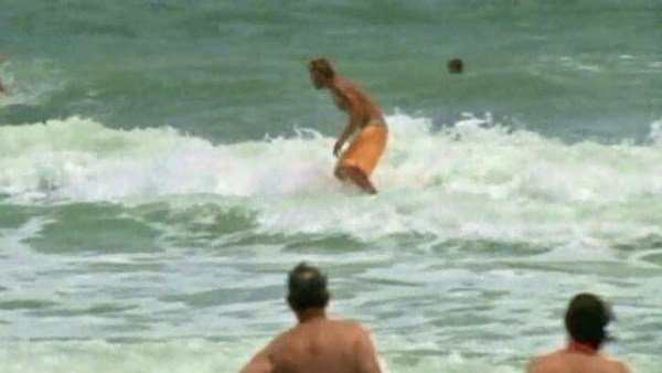 Though it may not be safe, surfers took to the waves of Cocoa Beach, FL, on Wednesday. (Source: WKMG/CNN)