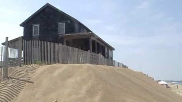 Some residents piled beach sand in front of their homes as a protective barrier. (Source: CNN)