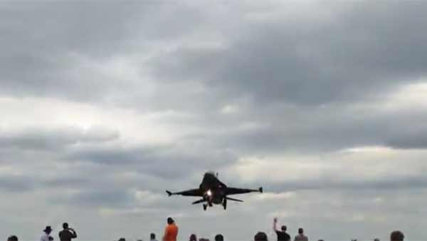 Onlookers at a British air show had an up close and personal look at a fighter jet as it attempted to land. (Source: Baz300zx/YouTube)