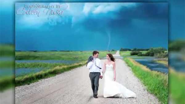 A Canadian photographer caught nature's best photobomb when she captured a tornado during a wedding photoshoot. (Source: Colleen Niska/Colleen Kiska Photography/CNN)
