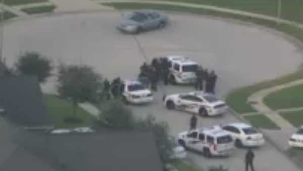 A three-hour standoff near Houston ended after a suspect gunman surrendered. (Source: KTRK/CNN)