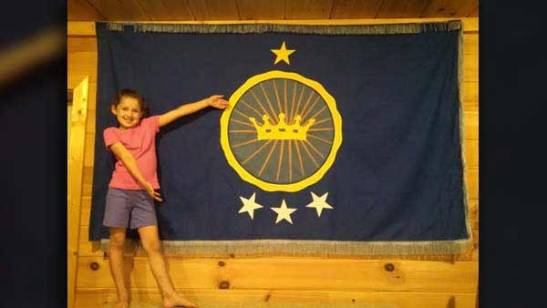Princess Emily poses with the flag of the 'Kingdom of Northern Sudan.' (Source: Jeremiah Heaton)