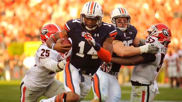 Auburn's Nick Marshall is one of just a handful of starting quarterbacks who return as the starter, but he's facing a possible suspension.