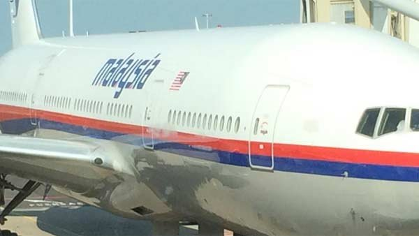 A passenger apparently boarding Malaysia Airlines Flight 17 posted a photo of the plane with the caption 'In case it disappears, this is what it looks like.' (Source: Cor Pan/Facebook)