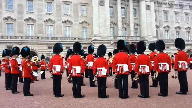 The Queen's Guard of England held an impromptu performance of the theme for HBO's 'Game of Thrones' outside Buckingham Palace. (Source: Omer Barnea/YouTube)