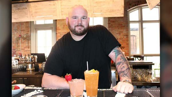 Bartender Justin Owens utilizes fresh fruits and vegetables in all of his house cocktails. (Source: Allison Scott)